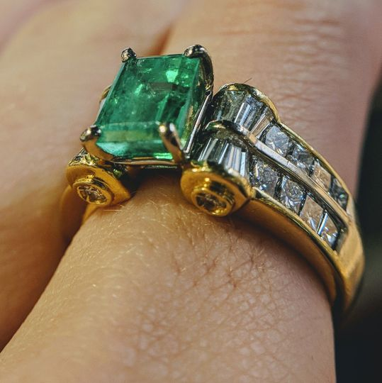 emerald and diamond engagement ring in 18k yellow gold custom designed and handmade by Secrète Fine...