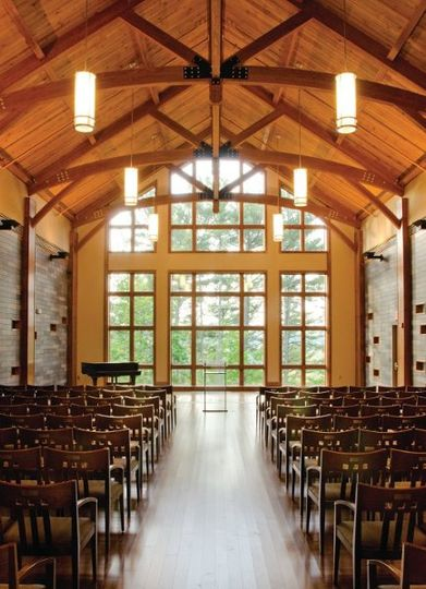 The Wilkes Family Chapel offers a wall of windows overlooking a wooded setting. Abundant natural...