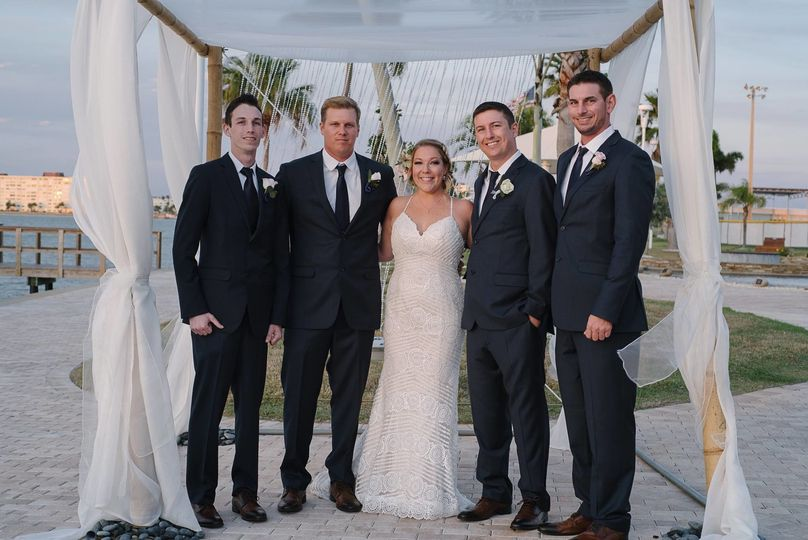 The couple with their groomsmen