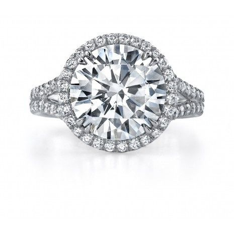 Classic Halo design with a elegant split shank available in white gold or platinum