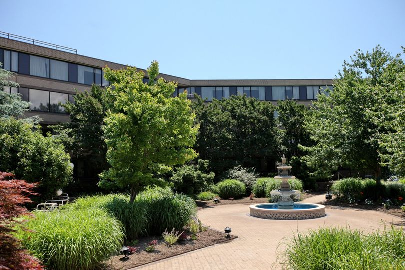 Tranquil beauty in the landscaped courtyard.  Perfect for outdoor receptions and photography.