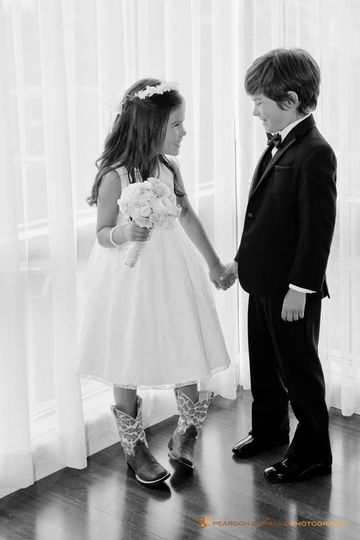 Flower girl with cowboy boots and ring bearer at four seasons hotel wedding.