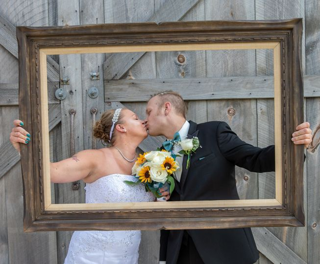 Kissing behind a frame
