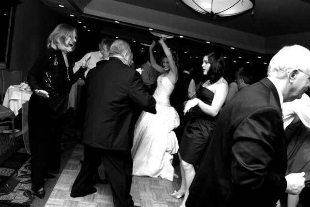 The bride dancing with her guests @ Wolfeboro Inn in Wolfeboro NH.