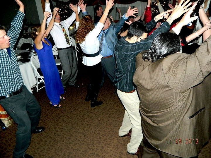 Guest dancing to YMCA at the Summit Resort Inn Gilford NH.