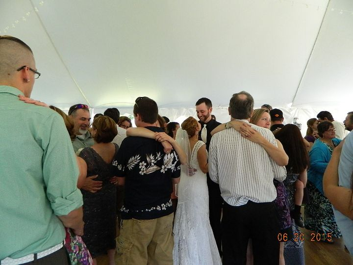 First dance taylor & michael on their wedding day with guests. Outside wedding in colebrook nh