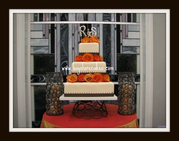 Tmx 1296609776405 3tierspacedorangeroseschocolatedotsandribbon Sandy wedding cake