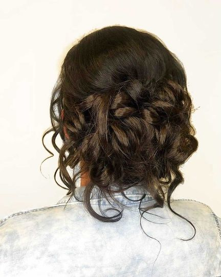 View of a loose curl bun from the back
