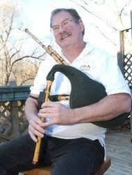Bob is playing the Border pipes.  This instrument sounds like a Highland bagpipe, except it is...