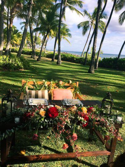 Custom Made Wood Sweetheart table, farm table design.  Boho Chic Outdoor Hawaiian Wedding. Venue...