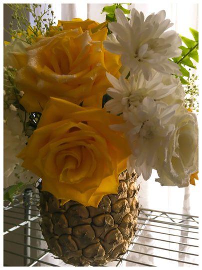 Golden Pineapple Flower Centerpieces. Destination wedding Hawaii. Design and decor provided by Bella...