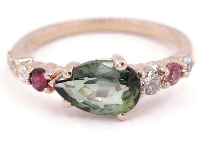 Teardrop green engagement ring