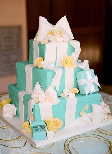 A perfect fit for this Tiffany-themed wedding: a cake resembling stacked Tiffany boxes, with ONE...