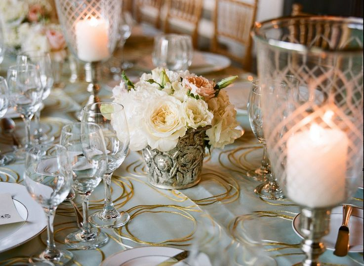 Elegant dinner table setting - gold, silver and crystal