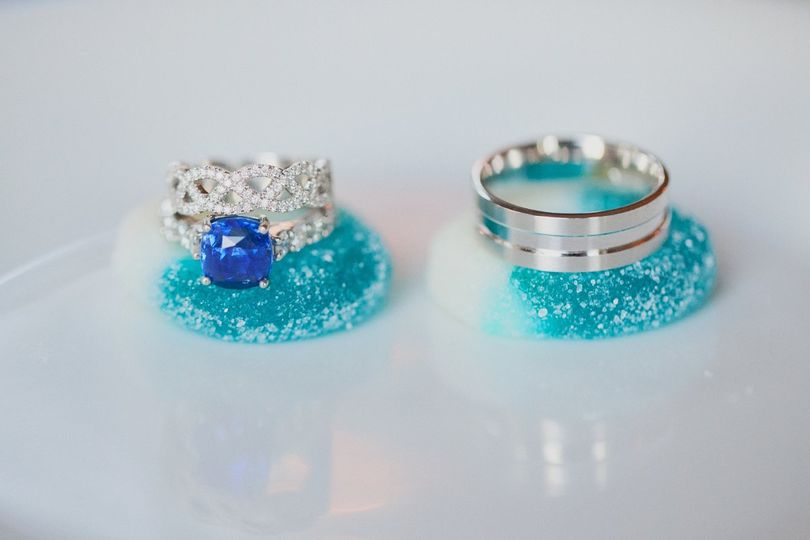 Platinum, diamond and sapphire rings playfully displayed on gummy candy from the blue-and-gold candy...