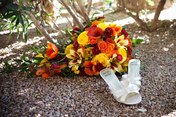 Gorgeous fall cascading bouquet including calla lilies, orchids and seasonal flowers