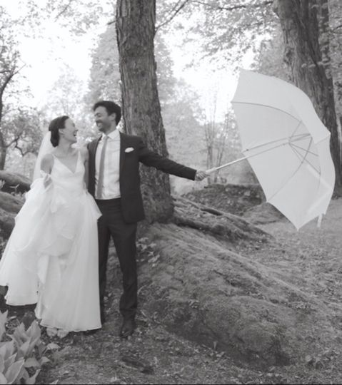 Couple poses with an umbrella