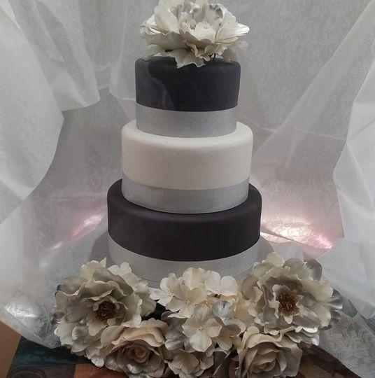 Black, silver, and white wedding cake
