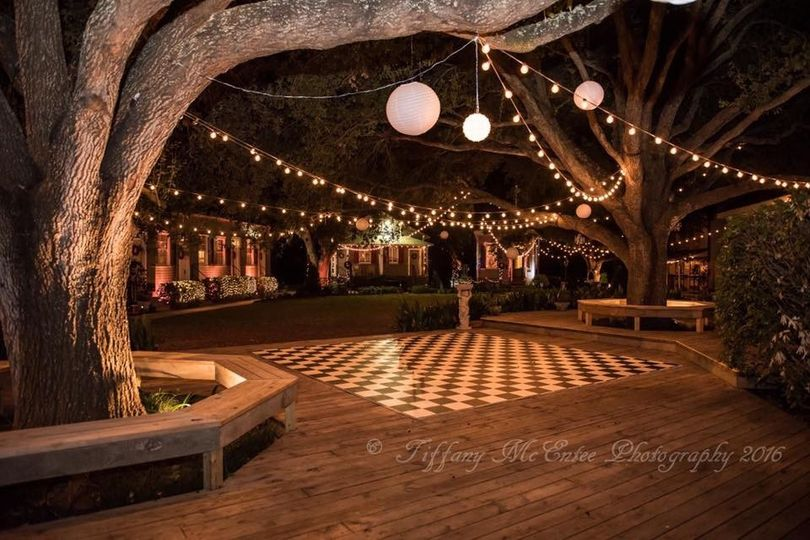 Outdoor wedding setup with bistro lights