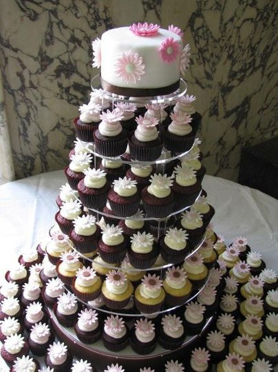 200 cupcake wedding tier. Wedding flowers were gerber daisies and decorations on cake topper and...