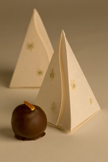 1-piece pyramid favor box. Fair-trade, tree-free compostable box filled with one delicious truffle.