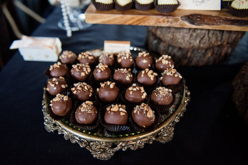 Rustic wood rounds mixed with vintage silver & gold accents, all topped with delicious truffles!