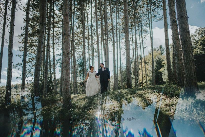 Newlyweds taking a walk in the woods
