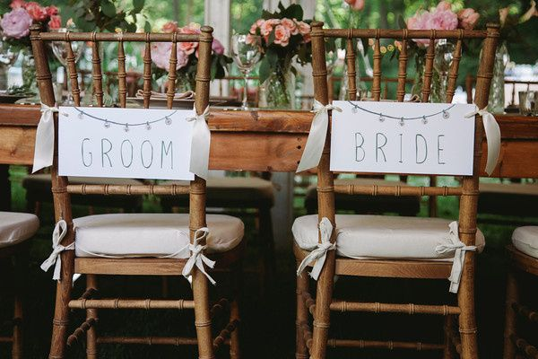 Custom signage for bride & groom's chairs