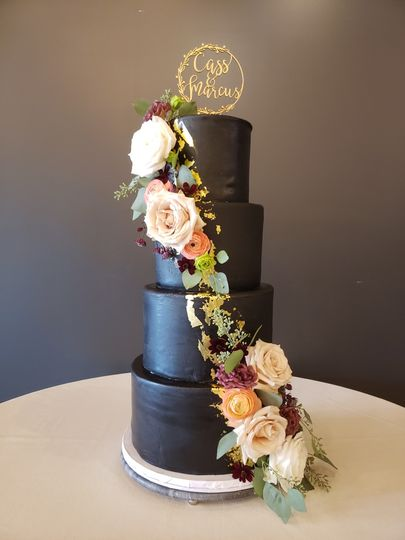 Black cake with ascending flower design