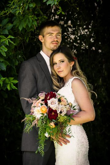 Couple with their beautiful bouquet