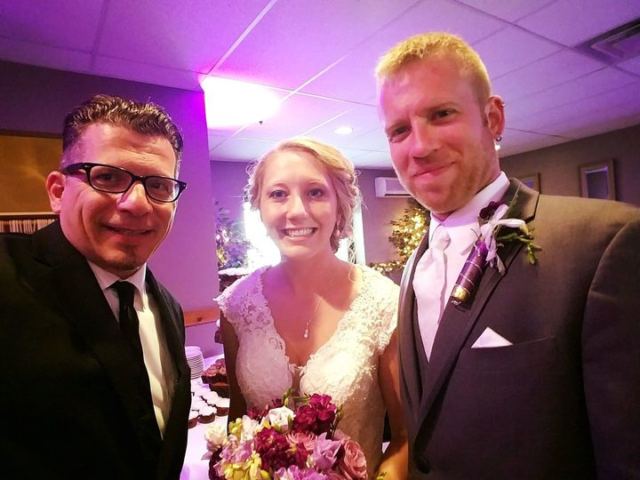 With the officiant and the newlyweds