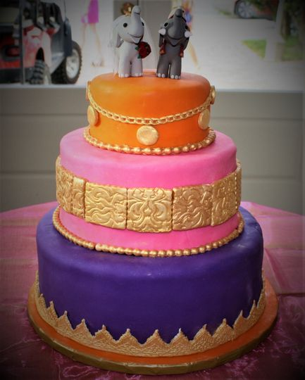 Purple, pink and orange wedding cake