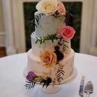 White wedding cake with spring flowers