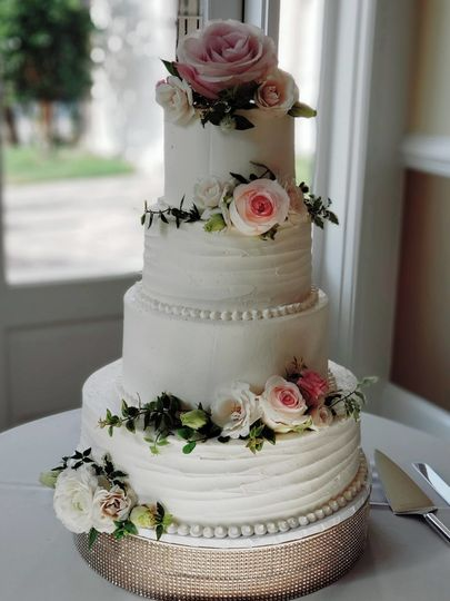 White wedding cake with soft pink flowers