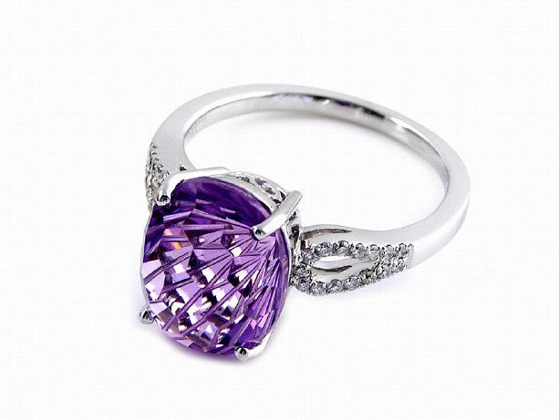 This beautiful designer fashion ring is unique with its specialty cut center stone. The Daisy Cut...