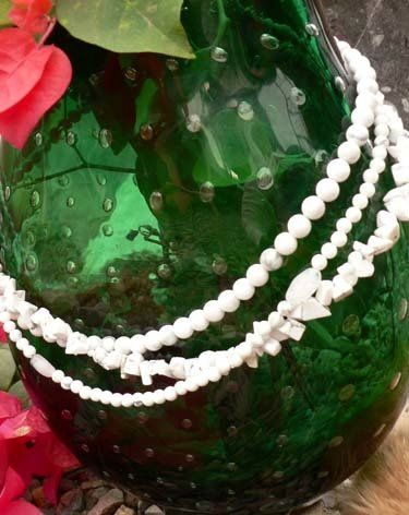 An earthy twist on the simple strand of pearls.  Howlite is a beautiful bright white stone with...