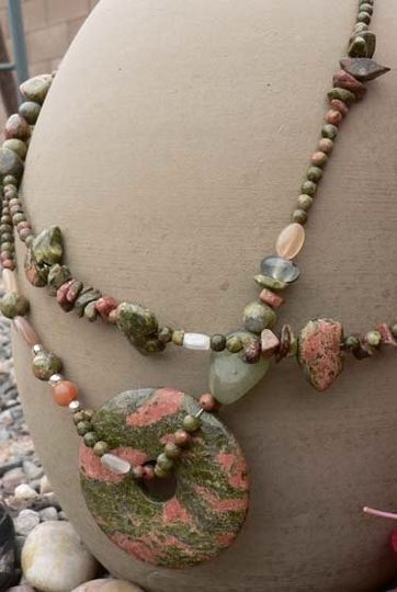 Unakite is a rare type of granite with vibrant peaches and greens making it a very special stone for...