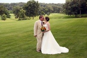 Wedding Kiss with lush greens as background.