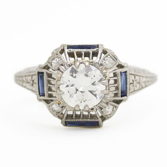 estate diamond engagement ring with side sapphire