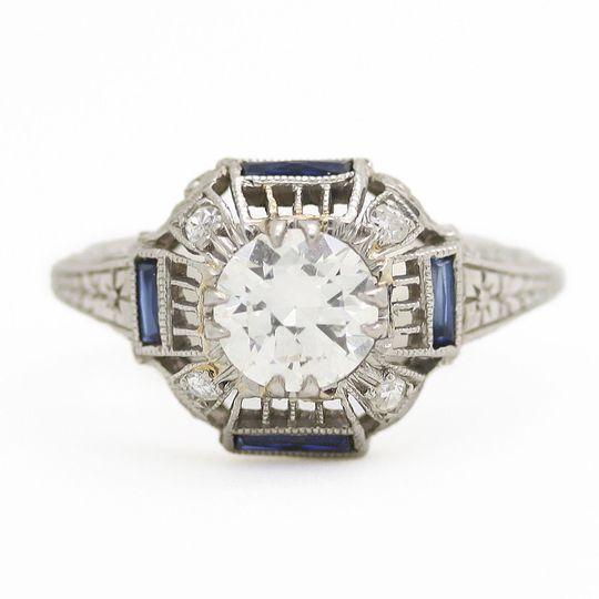 4e6e2790314c28c3 1483022734154 estate diamond engagement ring with side sapphire