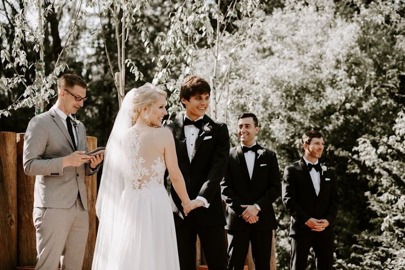 Couple holding hands at ceremony