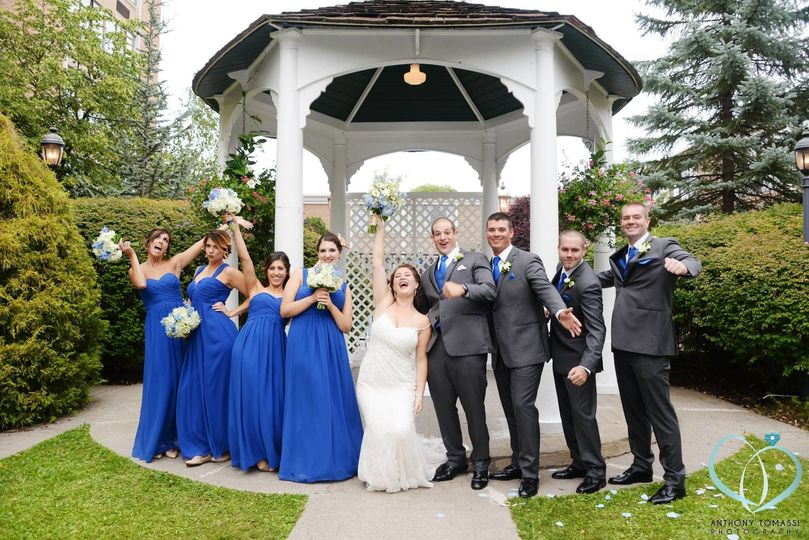 Newlyweds and their guests by the gazebo