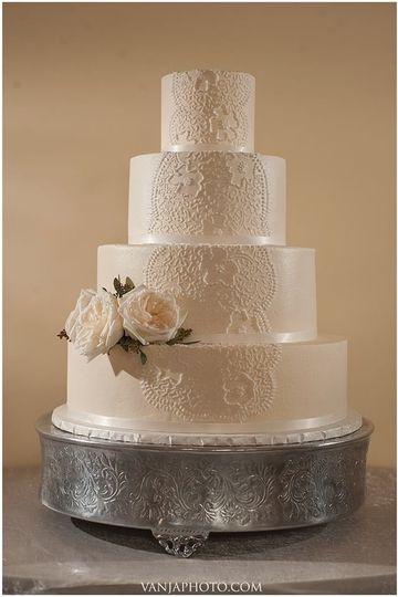 White rose on wedding cake