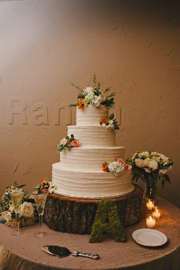 Wedding cake on wooden platform