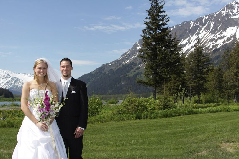 The grounds of Seward Windsong Lodge are the perfect setting for unique wedding photos.