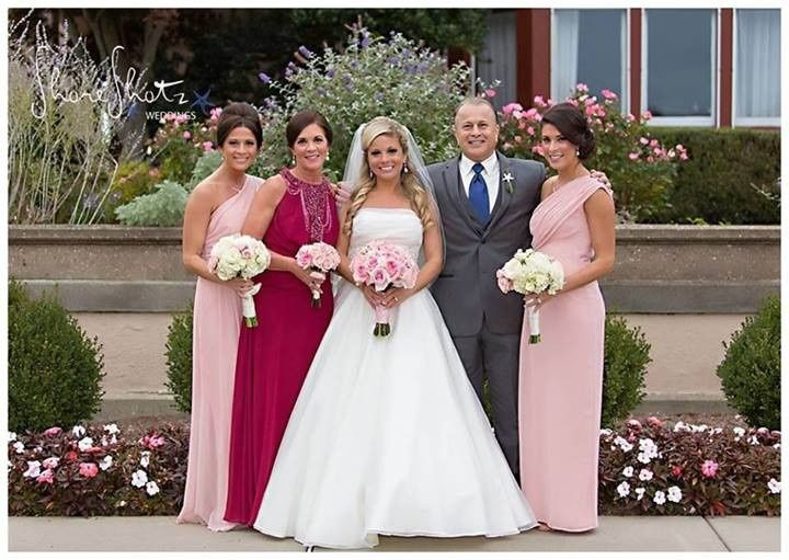 Smiling bride with loved ones