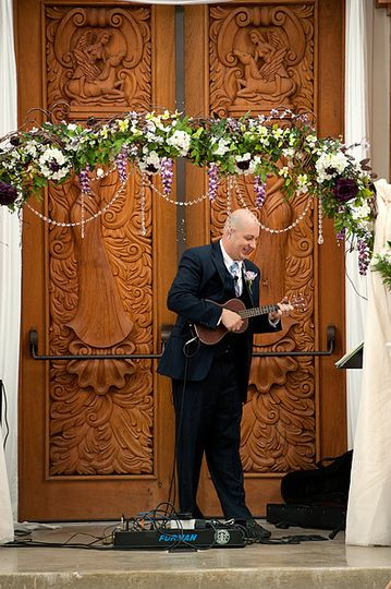 Mike bell playing ukulele as the bride walks down the aisle