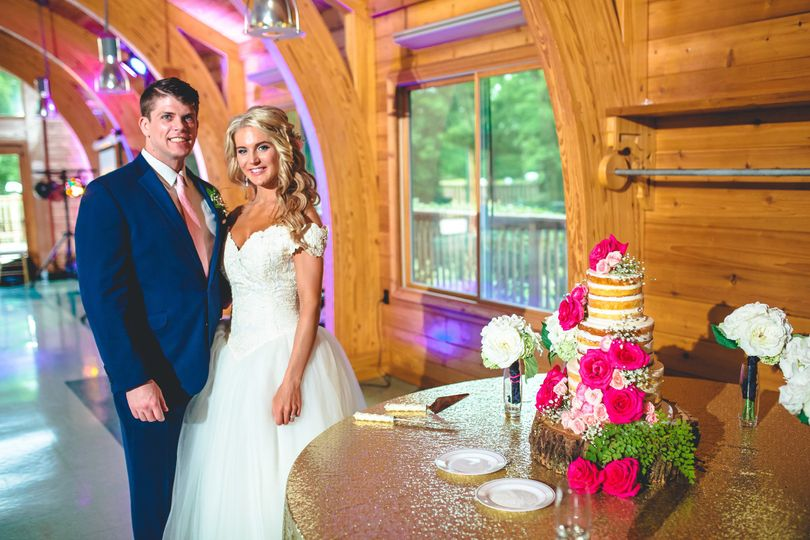 The couple with their wedding cake