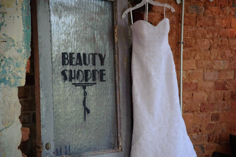 The wedding gown hanging up