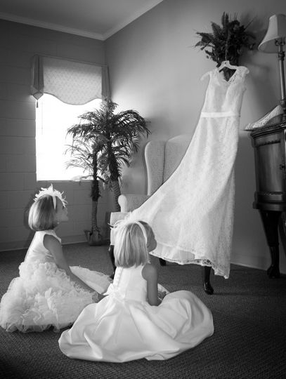 Little girls admiring the dress